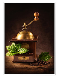 Póster Premium Coffee mill with beans and green leaves and a cup of coffee